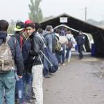 Sid, Serbia - October 17, 2015: Refugees waiting to cross the Serbo-Croatian border between the cities of Sid (Serbia) and Bapska (Croatia).