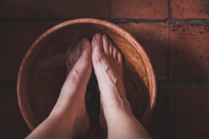 foot bath in a wooden bowl preparing for reflexology